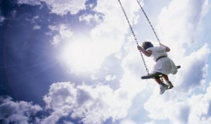 child_swinging_sky